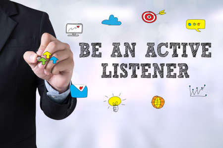 listener: BE AN ACTIVE LISTENER Businessman drawing Landing Page on blurred abstract background Stock Photo