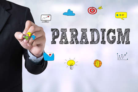 paradigm: PARADIGM Businessman drawing Landing Page on blurred abstract background Stock Photo