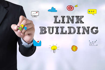 backlink: LINK BUILDING Businessman drawing Landing Page on blurred abstract background