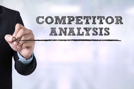 competitor: COMPETITOR ANALYSIS Businessman drawing Landing Page on blurred abstract background