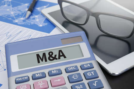mergers: M&A (MERGERS AND ACQUISITIONS) Calculator  on table with Office Supplies. ipad