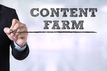 topicality: CONTENT FARM Businessman drawing Landing Page on blurred abstract background Stock Photo