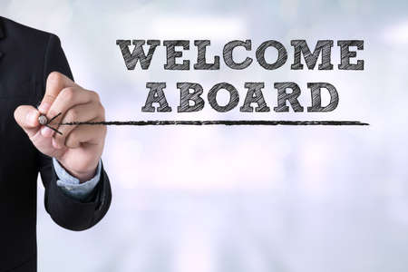 acceptable: WELCOME ABOARD Businessman drawing Landing Page on blurred abstract background