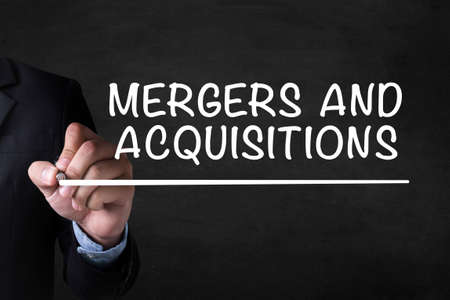 ownership and control: MERGERS AND ACQUISITIONS   M&A  and Businessman drawing  Page on blackboard