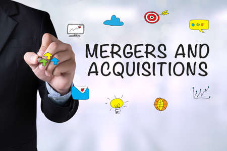 mergers: MERGERS AND ACQUISITIONS   M&A  and Businessman drawing Landing Page on blackboard
