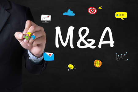 ownership and control: M&A (MERGERS AND ACQUISITIONS) Businessman drawing Landing Page on blurred abstract background