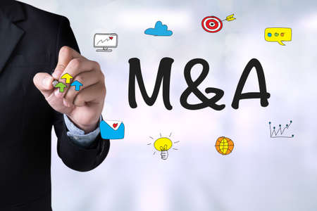acquisitions: M&A (MERGERS AND ACQUISITIONS) and Businessman drawing Landing Page on blackboard