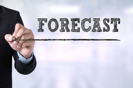 predictable: FORECAST Businessman drawing Landing Page on blurred abstract background