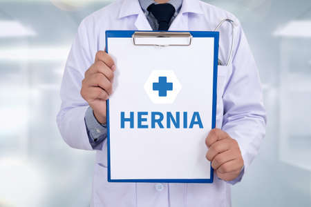 hernia: HERNIA Portrait of a doctor writing a prescription