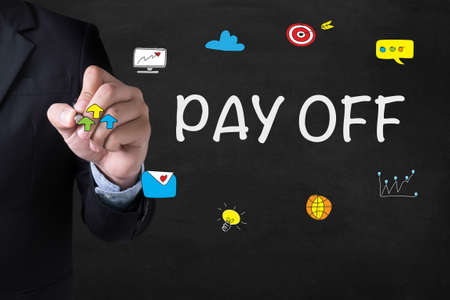 pay off: PAY OFF Businessman drawing Landing Page on blurred abstract background