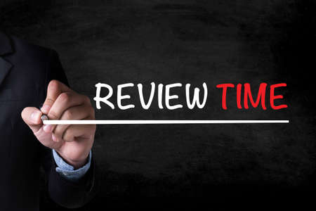 reassessment: REVIEW TIME and Businessman drawing  Page on blackboard
