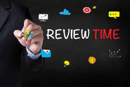 reassessment: REVIEW TIME Businessman drawing Landing Page on blurred abstract background