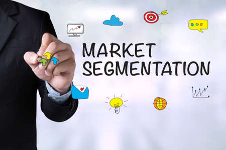 stationery needs: MARKET SEGMENTATION and Businessman drawing Landing Page on blackboard