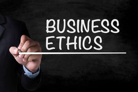 ethics: BUSINESS ETHICS and Businessman drawing  Page on blackboard