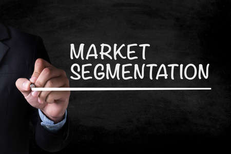 stationery needs: MARKET SEGMENTATION and Businessman drawing  Page on blackboard
