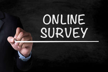 appraise: ONLINE SURVEY and Businessman drawing  Page on blackboard