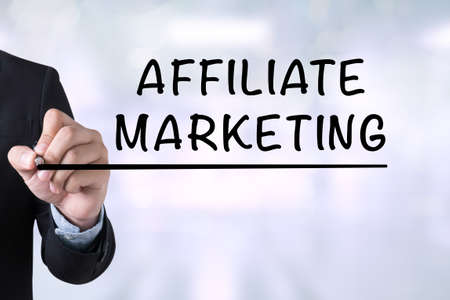 contextual: AFFILIATE MARKETING Businessman drawing on blurred abstract background