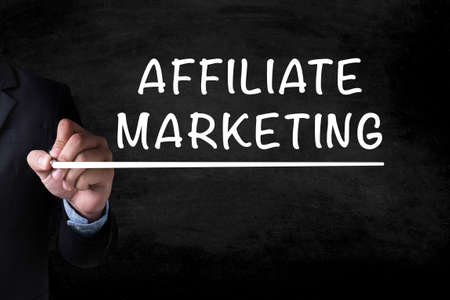 contextual: AFFILIATE MARKETING and Businessman drawing on blackboard