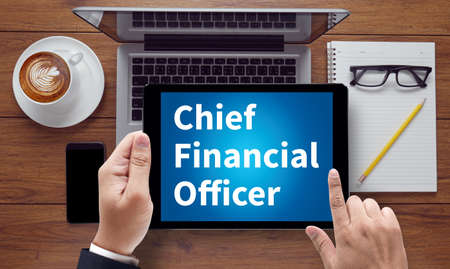 loss leader: CFO: Chief Financial Officer, on the tablet pc screen held by businessman hands - online, top view