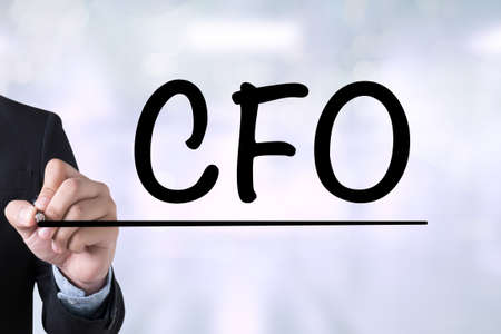 cfo: CFO: Chief Financial Officer Businessman drawing on blurred abstract background Stock Photo