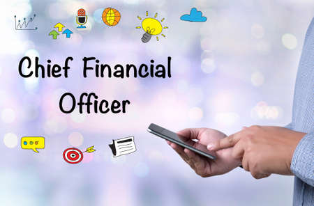 cfo: CFO    Chief Financial Officer person holding a smartphone on blurred cityscape background