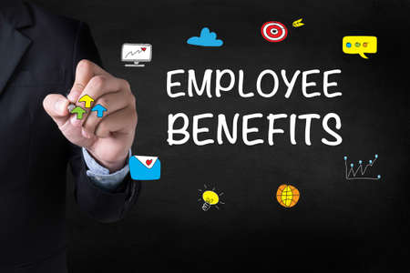 additional compensation: EMPLOYEE BENEFITS Businessman drawing on blurred abstract background