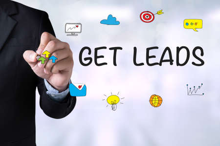 leadership key: GET LEADS and Businessman drawing on board