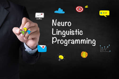 neuro: NLP Neuro Linguistic Programming Businessman drawing on blurred abstract background Stock Photo