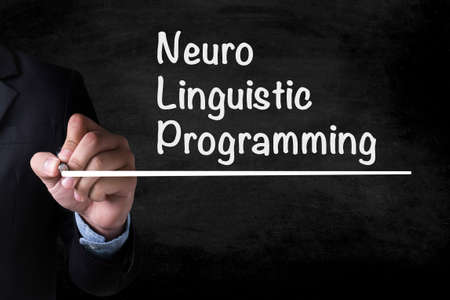 neuro: NLP Neuro Linguistic Programming and Businessman drawing on blackboard Stock Photo