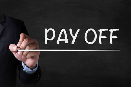 pay off: PAY OFF and Businessman drawing  Page on blackboard