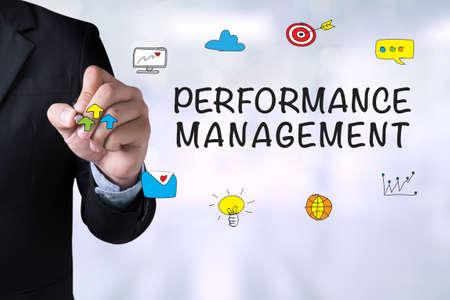 intervenes: PERFORMANCE MANAGEMENT and Businessman drawing on blackboard Stock Photo