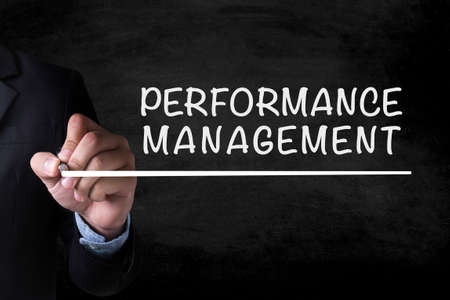 documented: PERFORMANCE MANAGEMENT and Businessman drawing  Page on blackboard