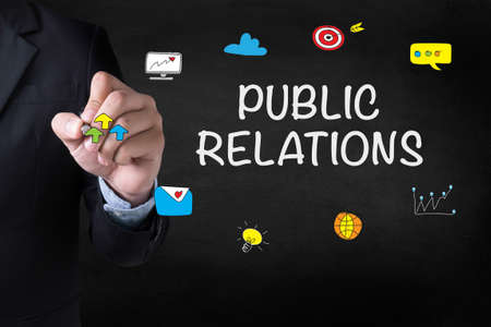 relation: PUBLIC RELATIONS Businessman drawing on blurred abstract background Stock Photo