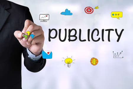 publicity: PUBLICITY and Businessman drawing on board Stock Photo