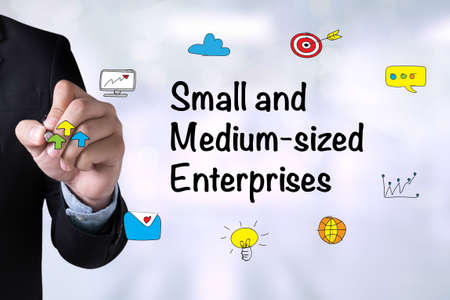 enterprises: SME or Small and medium-sized enterprises and Businessman drawing on board