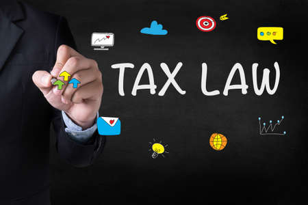 tax law: Tax Law Business Concept Businessman drawing Landing Page on blurred abstract background