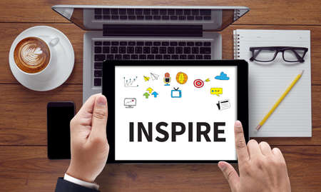 inspire: INSPIRE ( Inspire Ideas Creativity Inspiration ), on the tablet pc screen held by businessman hands - online, top view