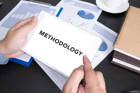 doing business: METHODOLOGY CONCEPT Modern people doing business, graphs and charts and touch-pad Stock Photo