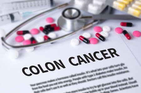 colon cancer: COLON CANCER and Background of Medicaments Composition, Stethoscope, mix therapy drugs doctor and selectfocus Stock Photo