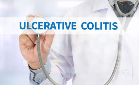colonoscopy: ULCERATIVE COLITIS Medicine doctor hand working on virtual screen