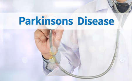 parkinson's disease: Parkinsons Disease Medicine doctor hand working on virtual screen Stock Photo