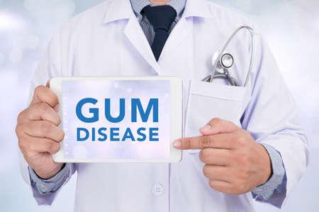 pathologic: GUM DISEASE CONCEPT Doctor holding  digital tablet