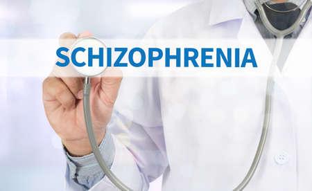 esquizofrenia: ESQUIZOFRENIA Medicina médico mano de trabajo en la pantalla virtual Foto de archivo