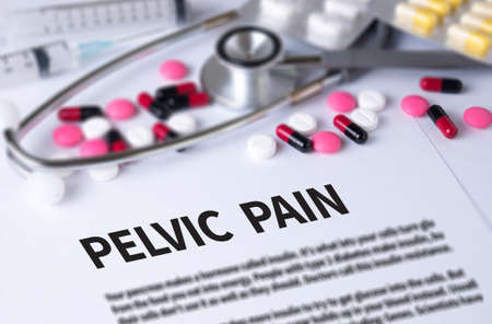 PELVIC PAIN and Background of Medicaments Composition, Stethoscope, mix therapy drugs doctor and selectfocus Stock Photo