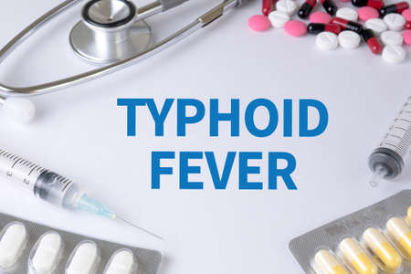 typhus: TYPHOID FEVER Text, On Background of Medicaments Composition, Stethoscope, mix therapy drugs doctor flu antibiotic pharmacy medicine medical