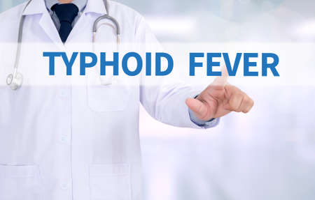 typhus: TYPHOID FEVER Medicine doctor working with computer interface as medical
