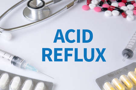 acid reflux: ACID REFLUX Text, On Background of Medicaments Composition, Stethoscope, mix therapy drugs doctor flu antibiotic pharmacy medicine medical Stock Photo