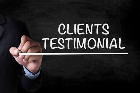 affirmations: CLIENTS TESTIMONIAL and Businessman drawing  Page on blackboard