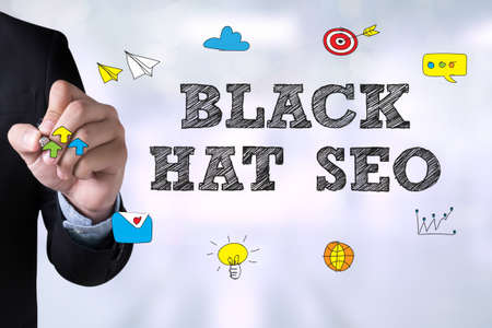 spamdexing: BLACK HAT SEO and Businessman drawing Landing Page on blackboard Stock Photo