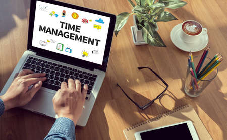 prioritizing: TIME MANAGEMENT man hand on table Business, coffee, Split tone Stock Photo